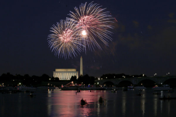 Fireworks explode over the Lincoln and Washington Monuments as Independence Day is celebrated in Washington July 4, 2014. Photo by Joshua Roberts/Reuters