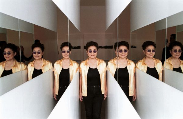 """Yoko Ono pauses at one of the entry points to her art work """"Entrance"""" at the Teatro Nacional in Brasilia, Brazil. Photo taken in 1998. Photo by Reuters"""