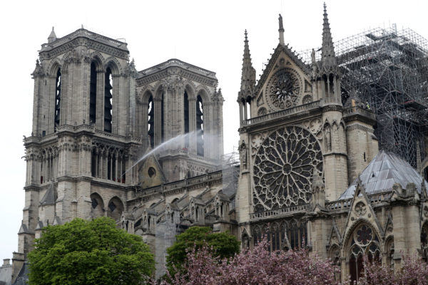Firefighters work at Notre-Dame Cathedral after a massive fire devastated large parts of the gothic gem in Paris, France on April 16, 2019. Photo by Yves Herman/Reuters