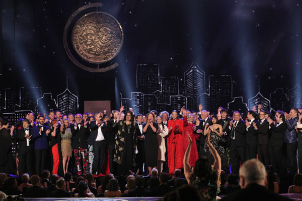 """The cast and crew of """"Hadestown"""" accept the award for Best Musical at the 73rd Annual Tony Awards. Photo by Brendan McDermid/Reuters"""