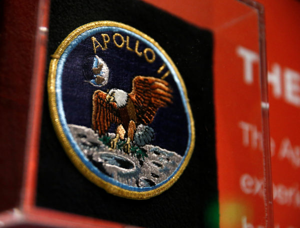 """An Apollo 11 mission patch is seen on the anniversary of the Apollo 11 mission launch at the """"Destination Moon: The Apollo 11 Mission"""" exhibit at the Museum of Flight in Seattle, Washington. Photo by Lindsey Wasson/Reuters"""