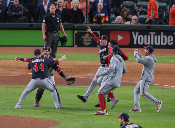 Washington Nationals pitcher Daniel Hudson (44) and catcher Yan Gomes (10) celebrate after defeating the Houston Astros in game seven of the 2019 World Series at Minute Maid Park. The Washington Nationals won the World Series winning four games to three. Mandatory Credit: Erik Williams-USA TODAY Sports