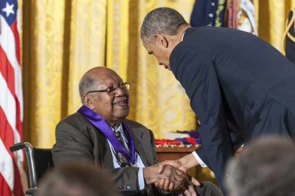 WASHINGTON, DC - JULY 10: U.S. President Barack Obama (R) presents a 2012 National Medal of Arts to Ernest Gaines for his contributions as an author and teacher, during a ceremony in the East Room of the White House on July 10, 2013 in Washington, DC. Gaines' works have shed new light on the African-American experience and given voice to those who have endured injustice. (Photo by Pete Marovich/Getty Images)
