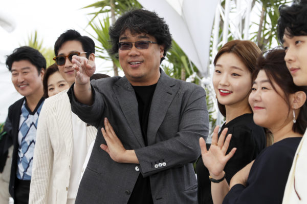 """FILE PHOTO: Bong Joon-ho, the director of the film """"Parasite"""" poses with his team at the 72nd Cannes Film Festival on May 22, 2019. Photo by Eric Gaillard/Reuters"""