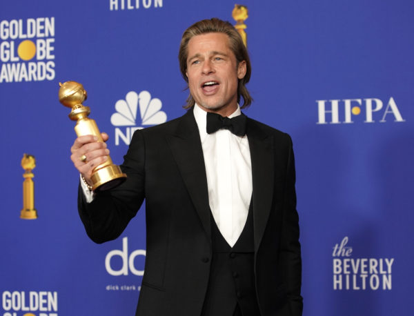 """Brad Pitt poses backstage with his award for Best Performance by an Actor in a Supporting Role in any Motion Picture for """"Once Upon a Time ... in Hollywood."""" Photo by Mike Blake/Reuters"""
