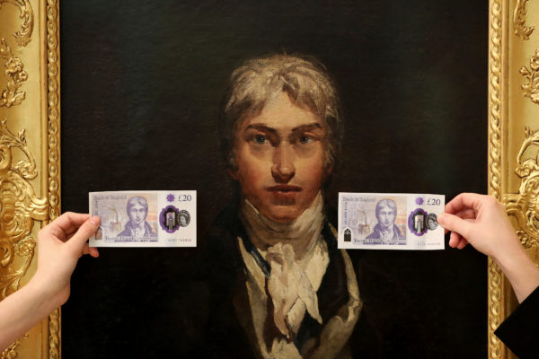 Employees hold the new 20 pound note featuring artist J.M.W. Turner in front of Turner's self portrait at the Tate Britain in London, Britain. Photo by Simon Dawson/Reuters