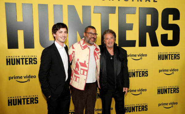 """Executive producer Jordan Peele and cast members Logan Lerman and Al Pacino pose at a premiere for the television series """"Hunters"""" in Los Angeles, California, February 19, 2020. Photo by Mario Anzuoni/Reuters"""