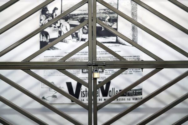 """Front view of artist Débora Delmar's installation """"Property/Propiedad"""" at this year's Material Art Fair in Mexico City. Photo by Joshua Barajas/PBS NewsHour"""