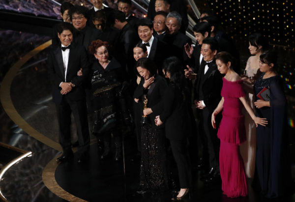 """Kwak Sin Ae and Bong Joon-ho win the Oscar for Best Picture for """"Parasite"""" at the 92nd Academy Awards in Hollywood, Los Angeles, California. Photo by Mario Anzuoni/Reuters"""