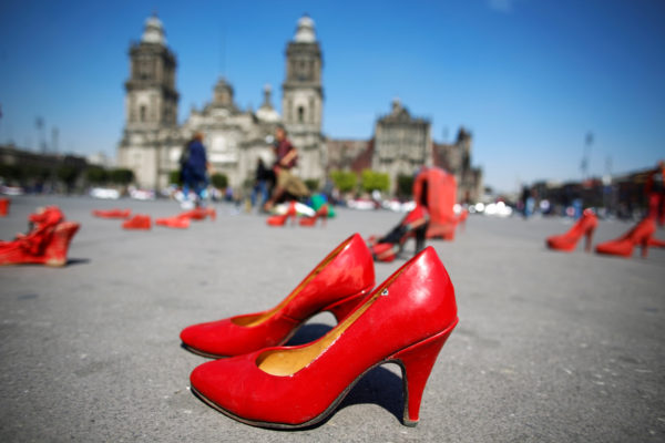 Pairs of women's red shoes, put on display by Mexican visual artist Elina Chauvet to protest against femicide, gender-based violence. Chauvet's installation was held at Zocalo square in Mexico City on Jan. 11, 2020. Photo by Gustavo Graf/Reuters