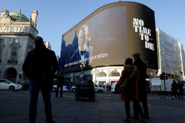 """A film trailer for the 25th installment in the James Bond series entitled """"No Time to Die"""" is displayed at Piccadilly Circus in London. Photo by Lisi Niesner/Reuters"""