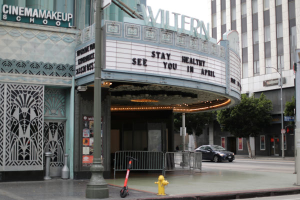 A theater displays a closed sign during the global outbreak of coronavirus (COVID-19) in Los Angeles, California, U.S., March 16, 2020. REUTERS/Lucy Nicholson