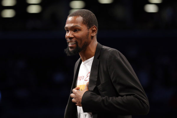 Feb 3, 2020; Brooklyn, New York, USA; Brooklyn Nets small forward Kevin Durant (7) smiles during a time out during the second quarter against the Phoenix Suns at Barclays Center. Mandatory Credit: Brad Penner-USA TODAY Sports