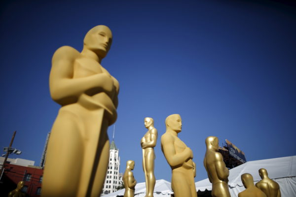 Oscar statues are painted outside the entrance to the Dolby Theatre as preparations continue for the 88th Academy Awards in Hollywood, Los Angeles, California February 25, 2016. The Oscars will be presented February 28, 2016. Photo by Lucy Nicholson/Reuters.