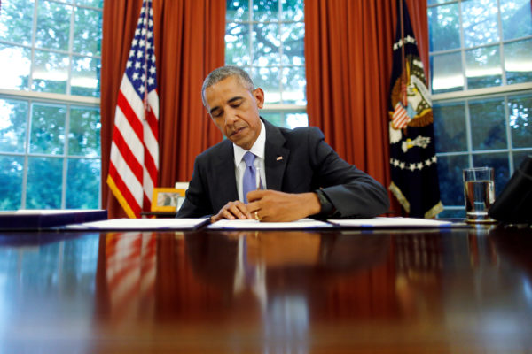 U.S. President Barack Obama signs into law S. 337: FOIA Improvement Act of 2016 and S. 2328: Puerto Rico Oversight, Management and Economic Stability Act at the Oval Office of the White House in Washington, U.S., June 30, 2016. Photo by REUTERS/Carlos Barria/File Photo