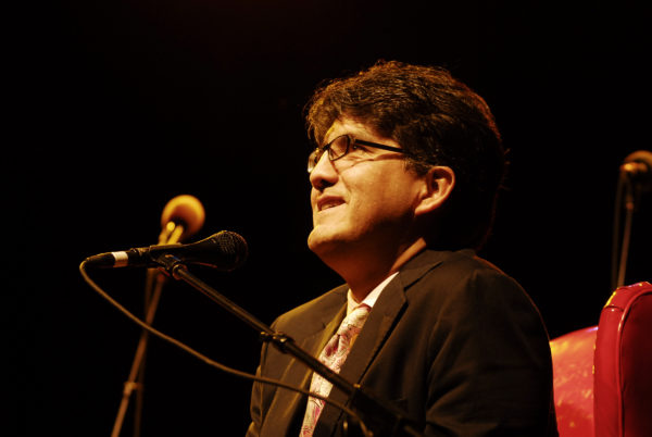 """Sherman Alexie interviewed on stage as part of the Live Wire! Radio Show at Aladdin Theater on October 10, 2009 in Portland, O.R. Alexie received criticism this week for including a poem in """"Best American Poetry 2015"""" by a white author using a Chinese name. Photo by Anthony Pidgeon/Redferns"""