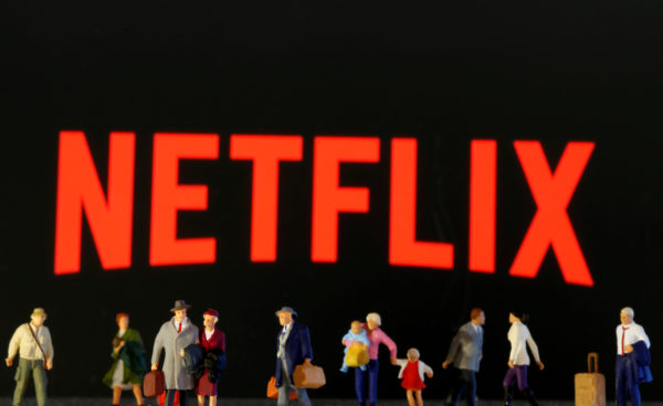FILE PHOTO: Small toy figures are seen in front of diplayed Netflix logo in this illustration taken March 19, 2020. Photo by Reuters/Dado Ruvic/Illustration/File Photo