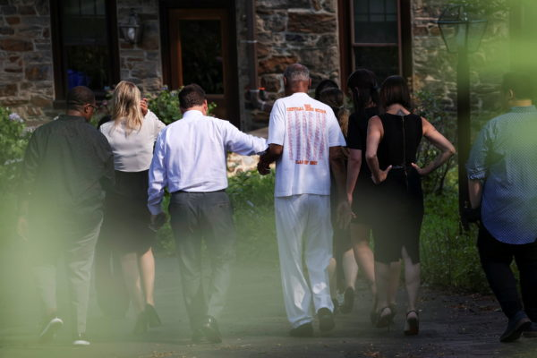 Bill Cosby walks to his house after Pennsylvania's highest court overturned his sexual assault conviction and ordered him ...