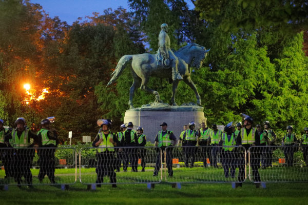 Police deploy around the statue of Civil War Confederate General Robert E. Lee in Charlottesville
