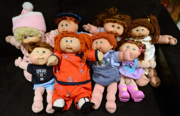 a pile of Cabbage Patch dolls