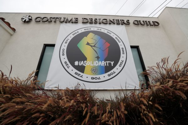 A banner hung in support of the the International Alliance of Theatrical Stage Employees (IATSE) is pictured outside the C...