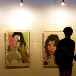 Iranians at Andy Warhol's portraits of Mick Jagger in Tehran's Museum of modern art February 12. [Ir..