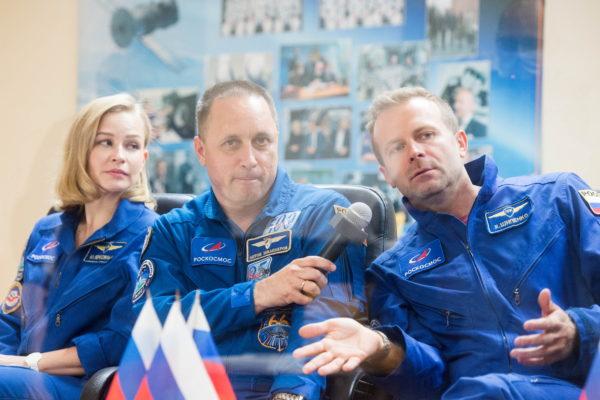 Crew members attend a news conference ahead of the expedition to the International Space Station at the Baikonur Cosmodrome